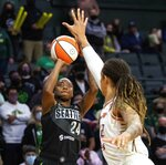 Seattle Storm's Jewell Loyd (24) shoots a WNBA basketball game's first basket, a two-point shot, over Phoenix Mercury's Brittney Griner during a WNBA basketball game Friday, Sept. 17, 2021, in Everett, Wash. (Dean Rutz/The Seattle Times via AP)
