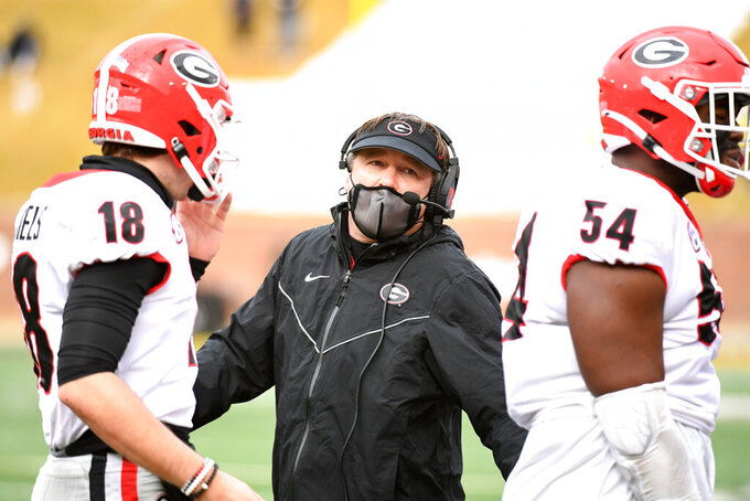 Georgia head coach Kirby Smart is seen on the sidelines during the first half of an NCAA college football game against Missouri Saturday, Dec. 12, 2020, in Columbia, Mo. (AP Photo/L.G. Patterson)