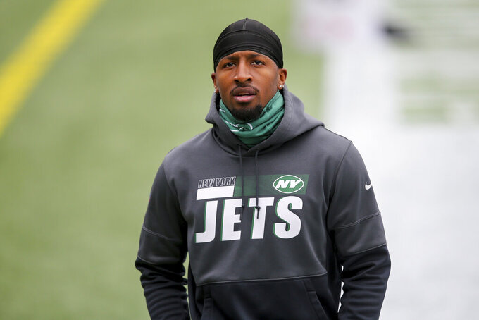 """FILE - New York Jets wide receiver Jeff Smith (16) is shown prior to an NFL football game in Foxborough, Mass., in this Sunday, Jan. 3, 2021, file photo. Jets wide receiver Jeff Smith is OK after being involved in a car accident Wednesday morning, Sept. 29, 2021. The 24-year-old Smith was driving to the team's facility when the crash occurred. There were no immediate details on the accident, but agent Garriet Blair told The Associated Press that Smith is """"good"""" physically and """"more upset about his new car."""" (AP Photo/Stew Milne, File)"""