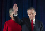 Australian Labor leader Bill Shorten gestures on stage with his wife Chloe, at the Federal Labor Reception in Melbourne, Australia, Saturday, May 18, 2019. Shorten has conceded defeat to Prime Minister Scott Morrison in the country's general election. Shorten made the announcement to supporters of his opposition Labor party late Saturday night in Melbourne. (AP Photo/Andy Brownbill)