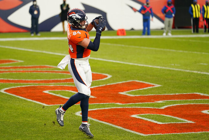Denver Broncos tight end Troy Fumagalli (84) catches a touchdown pass against the Las Vegas Raiders during the second half of an NFL football game, Sunday, Jan. 3, 2021, in Denver. (AP Photo/Jack Dempsey)