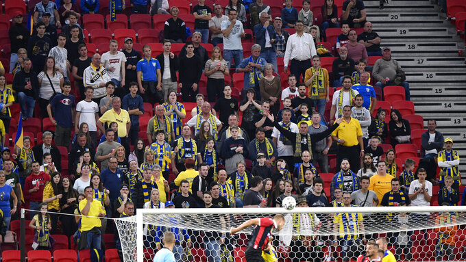 Fans of Mezokovesd Zsory FC are seen during the soccer Hungarian Cup final match Budapest Honved vs Mezokovesd Zsory FC in the Puskas Ferenc Arena in Budapest, Hungary, Wednesday, June 3, 2020. (Zsolt Szigetvary/MTI via AP)