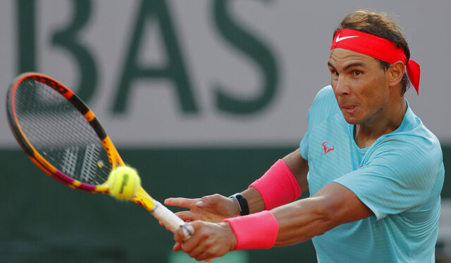 Spain's Rafael Nadal plays a shot against Argentina's Diego Schwartzman in the semifinal match of the French Open tennis tournament at the Roland Garros stadium in Paris, France, Friday, Oct. 9, 2020. (AP Photo/Michel Euler)