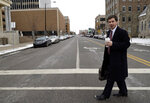 Mayor Pete Buttigieg talks with an AP reporter as he walks in downtown South Bend, Ind., Thursday, Jan. 10, 2019.  Few people know Pete Buttigieg's name outside the Indiana town where he's mayor, but none of that has deterred him from contemplating a 2020 Democratic presidential bid. He's among the potential candidates who believe 2016 and 2018 showed voters are looking for fresh faces.  (AP Photo/Nam Y. Huh)