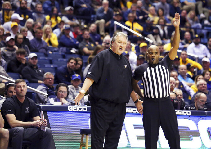 West Virginia Coach Bob Huggins reacts to a call during the second half of an NCAA college basketball game Monday Nov. 18, 2019, Morgantown, W.Va. (AP Photo/Kathleen Batten)