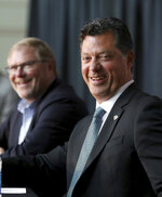 Minnesota Wild NHL hockey team owner Craig Leipold, left, laughs with new team general manager Bill Guerin at an introductory press conference in St. Paul, Minn., Thursday, Aug. 22, 2019.  (David Joles/Star Tribune via AP)