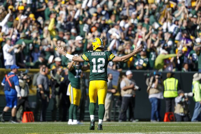 Green Bay Packers' Aaron Rodgers reacts after throwing a touchdown pass to Jake Kumerow during the first half of an NFL football game against the Oakland Raiders Sunday, Oct. 20, 2019, in Green Bay, Wis. (AP Photo/Jeffrey Phelps)