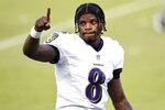 Baltimore Ravens' Lamar Jackson reacts as he walks off the field after winning an NFL football game against the Philadelphia Eagles, Sunday, Oct. 18, 2020, in Philadelphia. (AP Photo/Derik Hamilton)