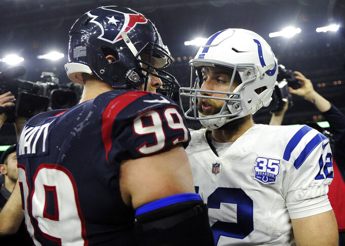 Houston Texans defensive end J.J. Watt (99) and Indianapolis Colts quarterback Andrew Luck (12) talk after their NFL wild card playoff football game, Saturday, Jan. 5, 2019, in Houston. Indianapolis won 21-7. (AP Photo/Eric Christian Smith)