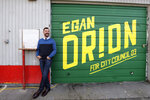 In this Monday, Oct. 28, 2019 photo, Seattle City Council candidate Egan Orion poses for a photo at his headquarters in Seattle. Seven of the nine Seattle City Council seats are up for grabs in next month's election, where retail giant Amazon has made unprecedented donations totaling $1.5 million to a political action committee that's supporting a slate of candidates perceived to be friendlier to business. Among the company's top targets is socialist council member Kshama Sawant, a fierce critic of Amazon, and Orion's opponent in the District 3 race. (AP Photo/Elaine Thompson)