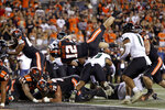Oregon State inside linebacker Jack Colletto (12) flies backwards into the end zone for a touchdown during the first half of an NCAA college football game against Hawaii Saturday, Sept. 11, 2021, in Corvallis, Ore. (AP Photo/Amanda Loman)