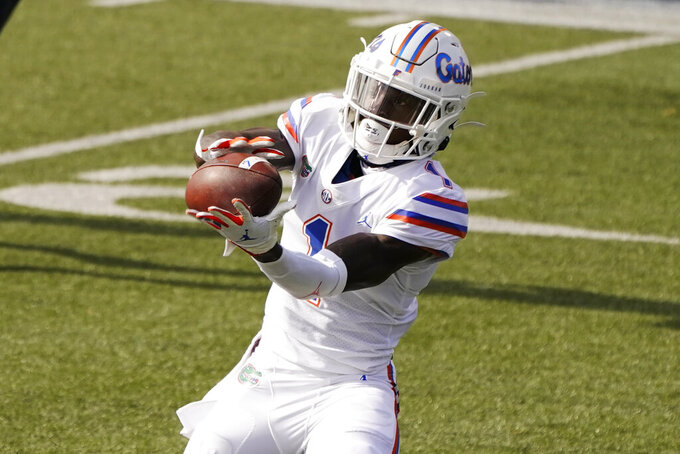 Florida wide receiver Kadarius Toney (1) catches a touchdown pass against Vanderbilt in the first half of an NCAA college football game Saturday, Nov. 21, 2020, in Nashville, Tenn. (AP Photo/Mark Humphrey)