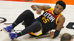Utah Jazz guard Donovan Mitchell rolls on the court after being fouled by Los Angeles Clippers guard Paul George during the second half of Game 2 of a second-round NBA basketball playoff series Thursday, June 10, 2021, in Salt Lake City. (AP Photo/Rick Bowmer)