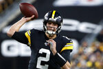FILE - In this Sunday, Nov. 10, 2019, file photo, Pittsburgh Steelers quarterback Mason Rudolph throws a pass during the first half of an NFL football game against the Los Angeles Rams, in Pittsburgh. The Pittsburgh Steelers play at the Cleveland Browns on Thursday, Nov. 14. (AP Photo/Don Wright, File)