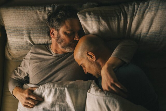 This image released by Bleecker Street shows Colin Firth, left, and Stanley Tucci in a scene from