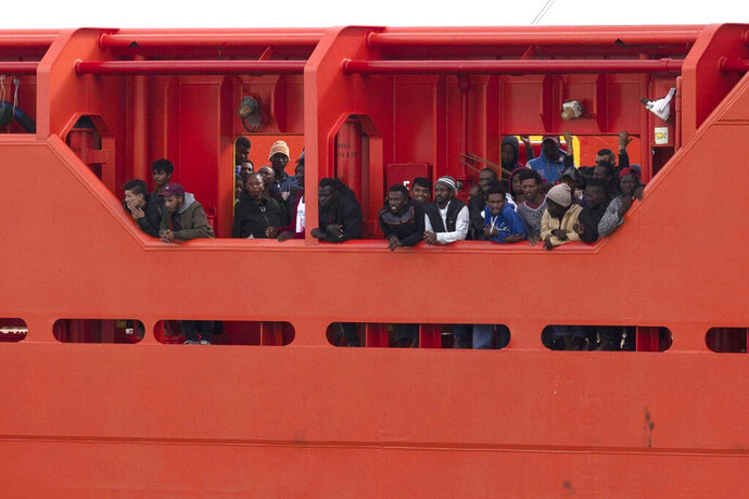 Migrants wait to disembark from the Asso Trenta ship, as it reaches the port of Pozzallo, Italy, Sunday, Nov. 3,  2019. An Italian offshore supply vessel has brought 151 migrants to Sicily after rescuing them in waters off Libya a day earlier. (Francesco Ruta/ANSA via AP)