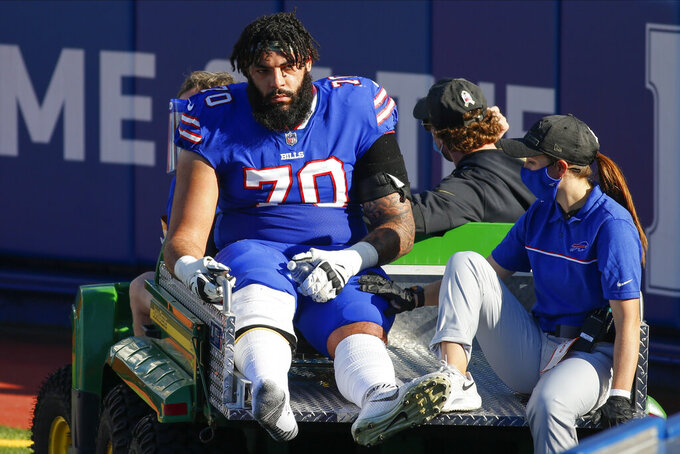 Buffalo Bills offensive guard Cody Ford (70) is carted off the field during the first half of an NFL football game against the Seattle Seahawks, Sunday, Nov. 8, 2020, in Orchard Park, N.Y. (AP Photo/Jeffrey T. Barnes)