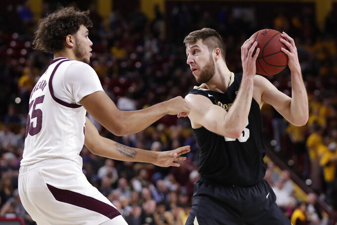 Colorado forward Lucas Stewart, right, looks to pass around Arizona State forward Taeshon Cherry during the first half of an NCAA college basketball game, Thursday, Jan. 16, 2020, in Tempe, Ariz. (AP Photo/Matt York)