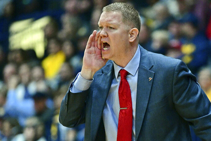 Youngstown State head coach Jerrod Calhoun shouts instructions during the first half of an NCAA college basketball game against West Virginia, Saturday, Dec. 21, 2019, in Youngstown, Ohio. (AP Photo/David Dermer)
