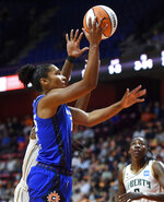 Connecticut Sun forward Alyssa Thomas scores her first basket of the season, against the New York Liberty during the first half of a WNBA basketball game Wednesday, Sept. 15, 2021, in Uncasville, Conn. (Sean D. Elliot/The Day via AP)