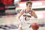 Texas Tech's Mac McClung (0) controls the ball during the first half of an NCAA college basketball game against Kansas in Lubbock, Texas, Thursday, Dec. 17, 2020. (AP Photo/Justin Rex)