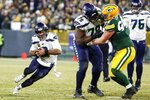 Seattle Seahawks' Russell Wilson runs for a first down during the second half of an NFL divisional playoff football game against the Green Bay Packers Sunday, Jan. 12, 2020, in Green Bay, Wis. (AP Photo/Matt Ludtke)