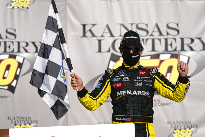Brandon Jones celebrates after winning a NASCAR Xfinity Series auto race at Kansas Speedway in Kansas City, Kan., Saturday, July 25, 2020. (AP Photo/Charlie Riedel)