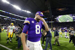 Minnesota Vikings quarterback Kirk Cousins (8) walks off the field after the team's NFL football game against the Green Bay Packers, Monday, Dec. 23, 2019, in Minneapolis. The Packers won 23-10. (AP Photo/Andy Clayton-King)