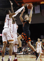 Oregon State 's Tres Tinkle, right, drives to the basket against Southern California during the first half of an NCAA college basketball game Saturday, Feb. 23, 2019, in Los Angeles. (AP Photo/Marcio Jose Sanchez)