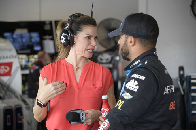 Fox Sports reporter Jamie Little, left, talks with driver Darrell Wallace Jr. in the garage area during a practice session for the NASCAR Daytona 500 auto race at Daytona International Speedway Saturday, Feb. 16, 2019, in Daytona Beach, Fla. (AP Photo/Phelan M. Ebenhack)