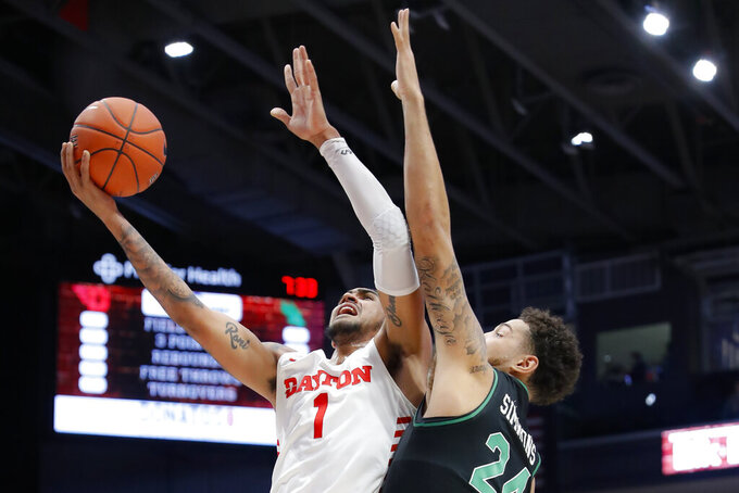 Dayton's Obi Toppin (1) shoots against North Texas' Zachary Simmons (24) during the first half of an NCAA college basketball game, Tuesday, Dec. 17, 2019, in Dayton, Ohio. (AP Photo/John Minchillo)