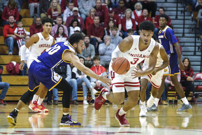 Indiana forward Justin Smith (3) comes up with a loose ball in front of Western Illinois guard Kobe Webster (10) in the first half of an NCAA college basketball game in Bloomington, Ind., Tuesday, Nov. 5, 2019. (AP Photo/AJ Mast)