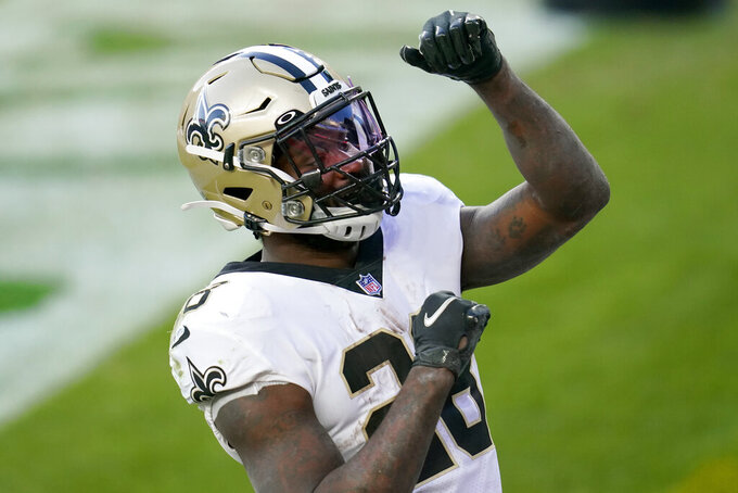 New Orleans Saints running back Latavius Murray celebrates his touchdown run against the Denver Broncos during the second half of an NFL football game, Sunday, Nov. 29, 2020, in Denver. (AP Photo/David Zalubowski)