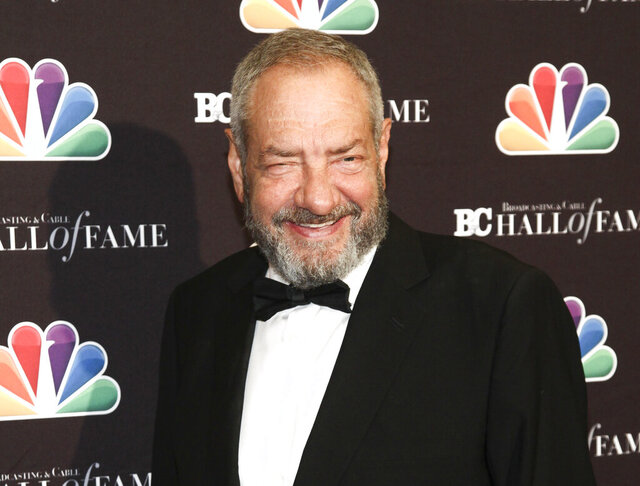 """FILE - This Oct. 16, 2017 file photo shows Dick Wolf at the Broadcasting & Cable Hall of Fame Awards 27th Anniversary Gala in New York. NBC has given three-season pickups to Wolf's """"Chicago Fire,"""" """"Chicago P.D.,"""