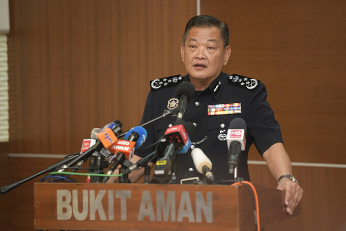Malaysia National police chief Abdul Hamid Bador speaks during a press conference at Police Headquarters in Kuala Lumpur, Malaysia, Friday, July 10, 2020. Malaysian police Friday grilled a team of reporters and staff from news broadcaster Al Jazeera over its documentary on the treatment of undocumented immigrants, that officials have slammed as unfair and bias. Abdul Hamid said the documentary released earlier this month had sparked public anger, and that initial probe showed it was inaccurate and depicted the country in a negative light. (AP Photo)