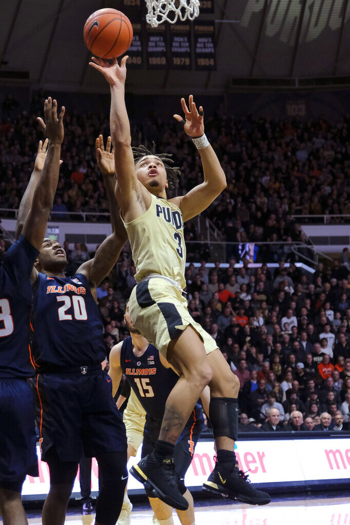 Purdue guard Carsen Edwards (3) shoots in front of Illinois guard Da'Monte Williams (20) during the second half of an NCAA college basketball game in West Lafayette, Ind., Wednesday, Feb. 27, 2019. Purdue won 73-56. (AP Photo/AJ Mast)