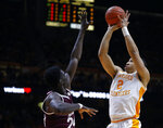 Tennessee forward Grant Williams (2) shoots over Mississippi State forward Abdul Ado (24) during the first half of an NCAA college basketball game Tuesday, March 5, 2019, in Knoxville, Tenn. (AP Photo/Wade Payne)