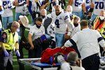 Dallas Cowboys quarterback Dak Prescott (4) is assisted by first responders and team medical staff onto a cart after suffering a leg injury running the ball against the New York Giants in the second half of an NFL football game in Arlington, Texas, Sunday, Oct. 11, 2020. (AP Photo/Michael Ainsworth)