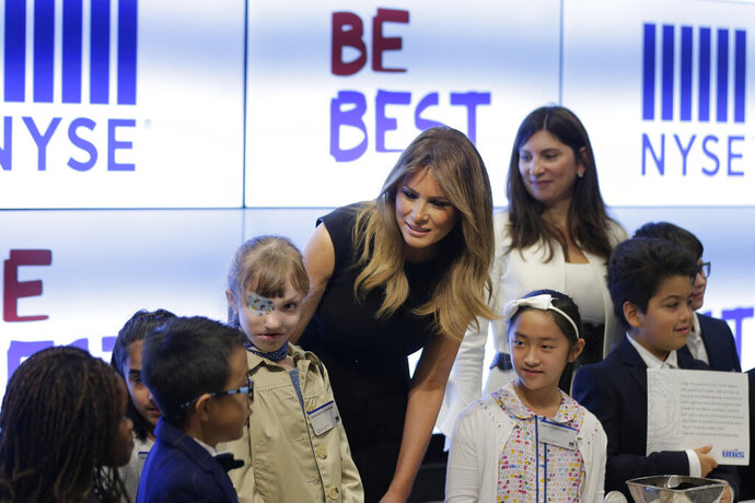 First Lady Melania Trump, center, talks with third and fourth graders from the United Nations International School during a tour of the New York Stock Exchange in New York, Monday, Sept. 23, 2019. (AP Photo/Seth Wenig)