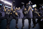 Army players celebrate a victory over Navy after an NCAA college football game, Saturday, Dec. 8, 2018, in Philadelphia. Army won 17 -10. (AP Photo/Matt Rourke)