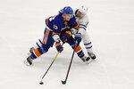 Toronto Maple Leafs' Zach Hyman (11) defends against New York Islanders' Mathew Barzal (13) during the third period of an NHL hockey game Wednesday, Nov. 13, 2019, in Uniondale, N.Y. The Islanders won 5-4. (AP Photo/Frank Franklin II)