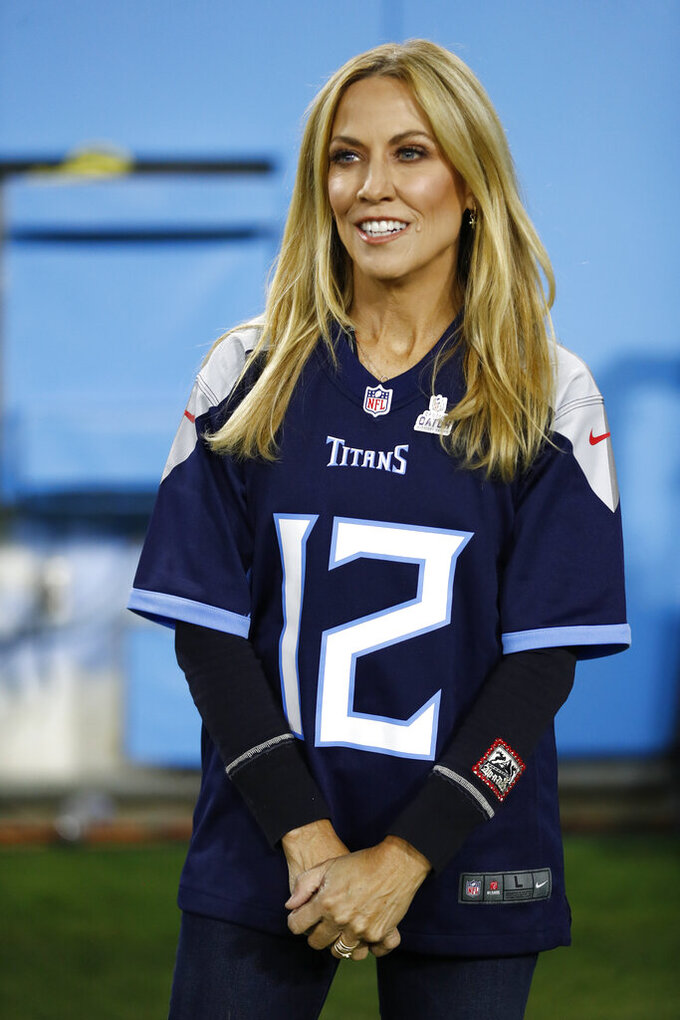 Singer Sheryl Crow watches as players warm up before an NFL football game between the Tennessee Titans and the Buffalo Bills Monday, Oct. 18, 2021, in Nashville, Tenn. (AP Photo/Wade Payne)