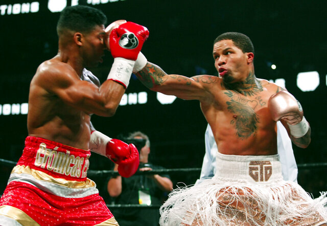 FILE - In this Dec. 29, 2019, file photo, Gervonta Davis, right, lands a punch on Yuriorkis Gamboa during round eight in their WBA lightweight bout in Atlanta. Davis wants to become a pay-per-view star, much like his promoter and mentor Floyd Mayweather Jr. was in his prime. He also wants to fight in front of a lot of screaming fans, though he'll have to settle for a pandemic-limited audience of ticket holders Saturday in San Antonio for his title matchup with veteran Leo Santa Cruz. (AP Photo/Tami Chappell, File)