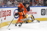 Nashville Predators' Alexandre Carrier (45) is tripped up as Edmonton Oilers' Joakim Nygard (10) carries the puck during second period NHL hockey action in Edmonton, Alberta, Tuesday, Jan. 14, 2019. (Jason Franson/The Canadian Press via AP)
