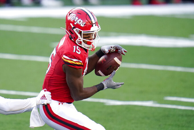 Maryland wide receiver Brian Cobbs (15) catches a touchdown pass against Rutgers during the second half of an NCAA college football game, Saturday, Dec. 12, 2020, in College Park, Md. Rutgers won 27-24 in overtime. (AP Photo/Julio Cortez)