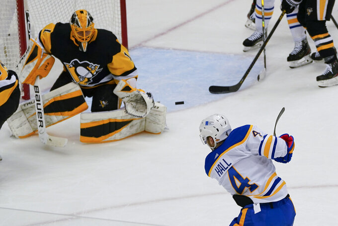 Buffalo Sabres' Taylor Hall (4) shoots at Pittsburgh Penguins goaltender Casey DeSmith (1) during the first period of an NHL hockey game, Thursday, March 25, 2021, in Pittsburgh. Hall did not score. (AP Photo/Keith Srakocic)