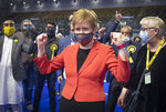 First Minister and SNP party leader Nicola Sturgeon celebrates after retaining her seat for Glasgow Southside at the count for the Scottish Parliamentary Elections in Glasgow, Scotland, Friday May 7, 2021. On winning her seat in Glasgow, Nicola Sturgeon, said early results indicated that her party was on course to win its fourth straight election in Scotland but that the final outcome would not emerge until Saturday evening. (Jane Barlow/PA via AP)