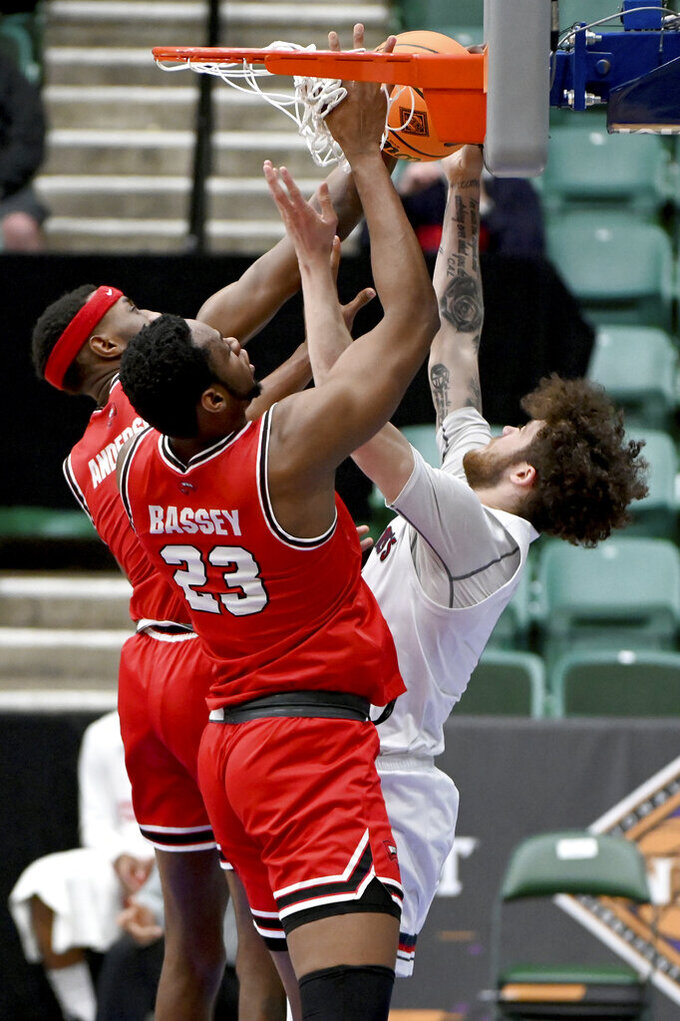 St. Mary's guard Logan Johnson (0) has his shot contested by Western Kentucky center Charles Bassey (23) and guard Josh Anderson (4) in the first half of an NCAA college basketball game in the first round of the NIT, Wednesday, March 17, 2021, in Frisco, Texas. (AP Photo/Matt Strasen)