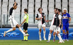 Juventus' Cristiano Ronaldo, left, celebrates after scoring his team's first goal during the Serie A soccer match between Juventus and Sampdoria at the Allianz stadium in Turin, Italy, Sunday, July 26, 2020. (AP Photo/Antonio Calanni)