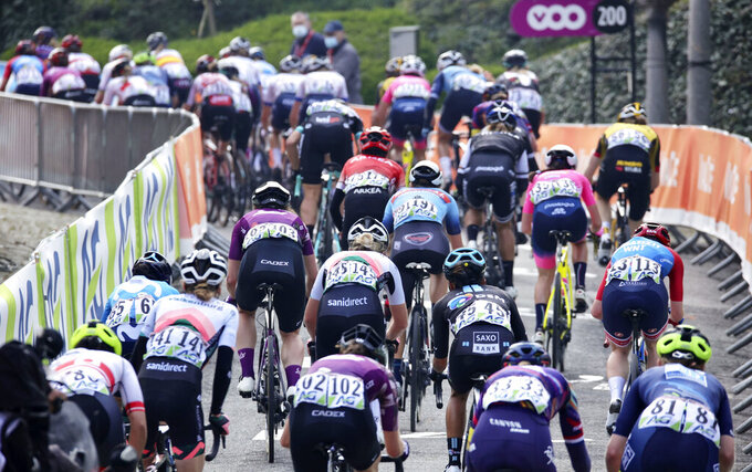 Riders climb the Wall of Huy during the Women's Belgian cycling classic and UCI World Tour race Fleche Wallonne, in Huy, Belgium, Wednesday, April 21, 2021. (AP Photo/Olivier Matthys)